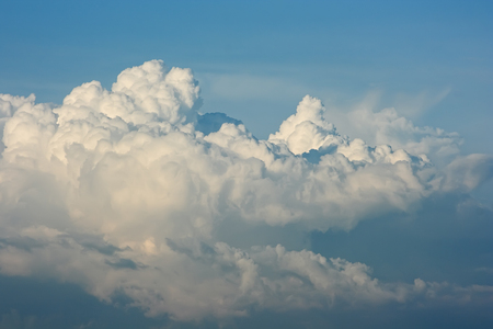 Cloud sky. White cumulus clouds are like a snow-covered mountain peaks.