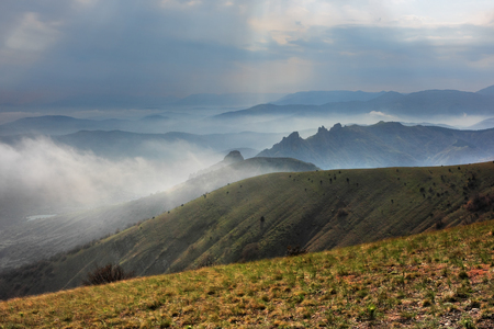 Crimean mountain landscape. Beautiful landscape with view on mountain ridges and valleys in rainy weather in the Crimea.