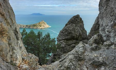 Wonderful landscape of Crimean nature. View of the Cape Kapchik and Cape Meganom in the distance on the horizon. Novy Svet, Crimea. Stock Photo