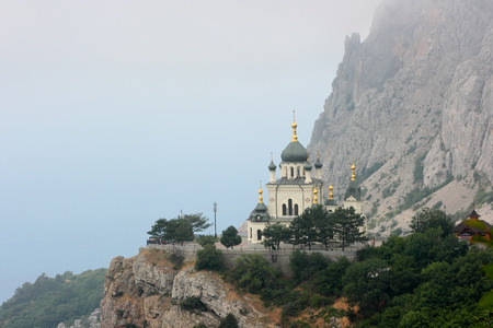 The Church of the Resurrection of Christ among the rocky mountains in Foros. Crimea. The church which rises on the rock island near the Black Sea.