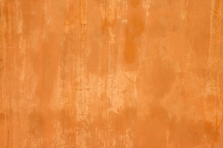 Orange wall texture. Wall painted orange with grunge effect.