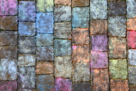 Texture of paving slabs in different colors of chalk. A multicolored background of a painted footpath. Stockfoto