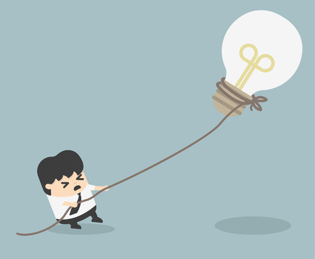 pulling rope: businessman pulling bulb with rope