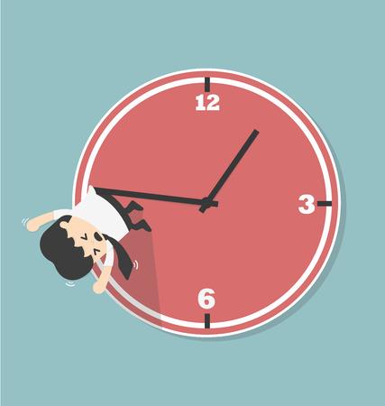 Homme d'affaires se bloque sur une flèche de l'horloge.