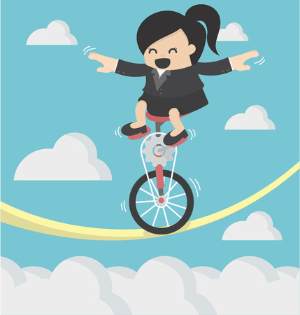 Business Woman riding bike one wheel on a rope