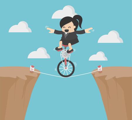 Business Woman riding bike une roue sur une corde