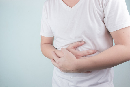Asian Young men are suffering from stomach ulcers. gastritis Caused by the infection of H. pylori bacteria healthcare and health problem concept