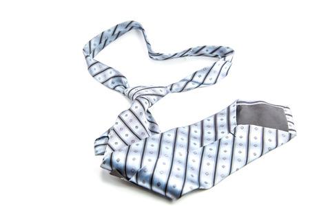 Gray necktie on a white  photo