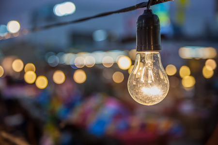 good business: Tungsten lamp with a bokeh background design Stock Photo