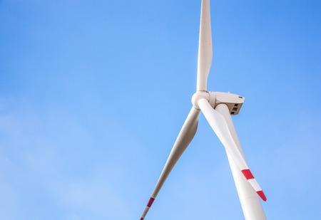 Wind Turbine for alternative energy on background sky photo