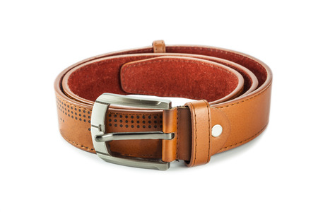 Brown leather belt on white background photo