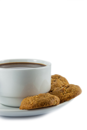 cup of coffee and cookies  on white  background photo
