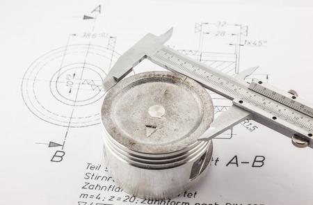 vernier caliper: Vernier Caliper measure  piston  on the drawing board Stock Photo
