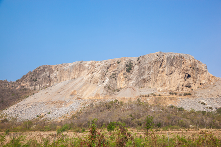 Big limestone quarry and blue sky Stock Photo
