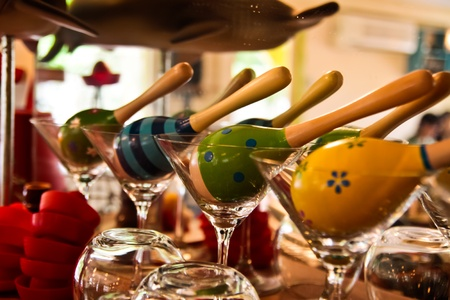 panpipe: the colorful rattles on the cocktail glasses. Stock Photo