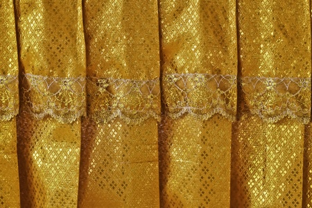 This picture shows Thai traditional gold curtain that is normally the decoratinf item of the temples and other historical places of Thailand. photo