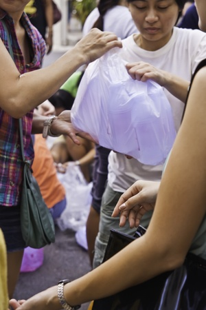During the flood crisis, Thai peoples and foreigners in Bangkok still devote themselves to help Red-Cross foundation to prepare the disaster relief packages and send to the flood victims in the risky areas.