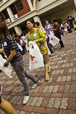 BANGKOK,THAILAND, 30 OCT 2011 - During the flood crisis, Thai peoples and foreigners in Bangkok still devote themselves to help Red-Cross foundation to prepare the disaster relief packages and send to the flood victims in the risky areas.