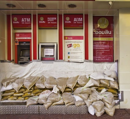 BANGKOK - NOVEMBER 3: The ATM of Thailand Government saving bank (GSB) is protected by the sandbags from the possible flood attack. Editorial