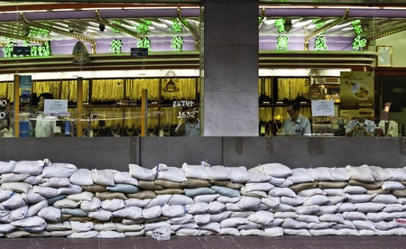 BANGKOK - NOVEMBER 3: The famous Gold shop in Chinatown of Thailand is alert to the possible flood attack by equipping the sandbags arrays in front of the shop.