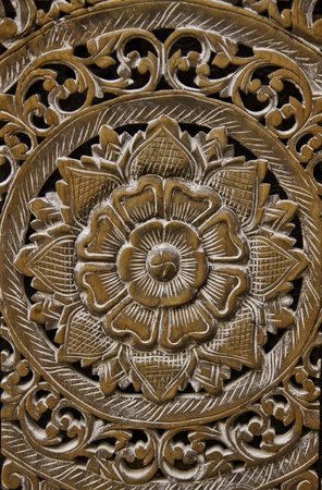 The wooden craft panel is the masterpiece of Thai craftman dedicated to the faith of buddhism and the aesthetics of the beauty of Thai culture. photo