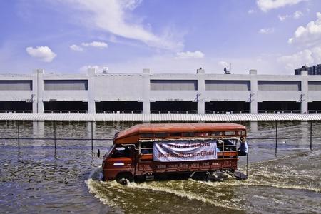 BANGKOK - 8 NOV 2011: Thailand flood crisis situation expands its coverage to the skytrain terminal builldings at Vibawadi Rungsit road.