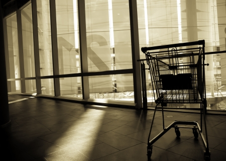 The shopping cart is abandoned after usage. Stock Photo