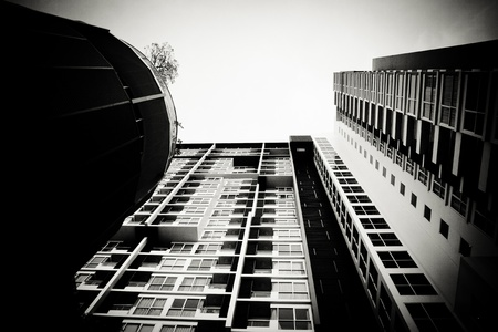 The skycraper is presented in the grungy monochrome theme of colour. photo