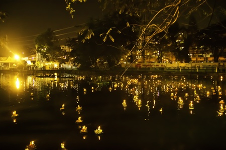 Loy Krathong is one of the most important festival of Thailand. It is held annually on every November. We will join this festival by letting the floating flowers plate on the rivers or ponds to ask for forgiveness from the holy spirit of water stream for  photo