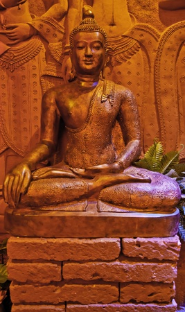 Red Buddha Statue in the sitting position at Buddha Dharma Relics Museum shows us the sacred and calm feeling whenever we look at this beautiful statue. Stock Photo