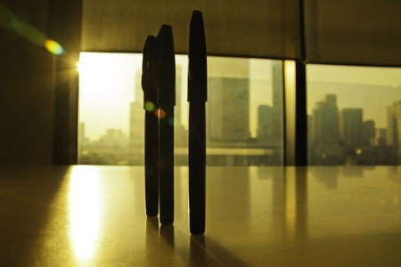 The 3 pens on the working table are as the source of all inspiration for design masterpiece of art. photo