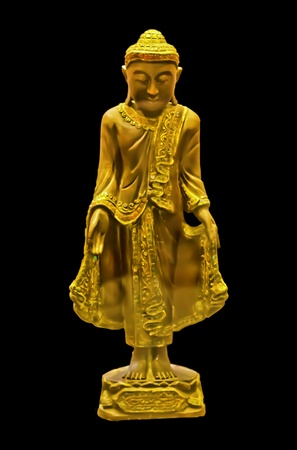 The great monk standing statue in black isolated background photo