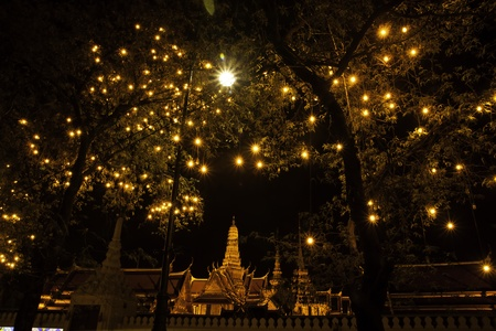 The Wat Phra Kaew or the Temple of the Emerald Buddha, with full official name Wat Phra Si Rattana Satsadaram, is regarded as the most sacred Buddhist temple (wat) in Thailand. photo