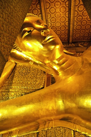 The beautiful reclining golden Buddha at Wat Pho of Bangkok Thailand. photo