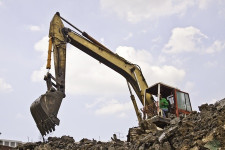 back hoe: The backhoe of the construction site.
