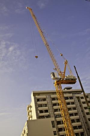 constrution: The constrution crane at the condominium site. Stock Photo