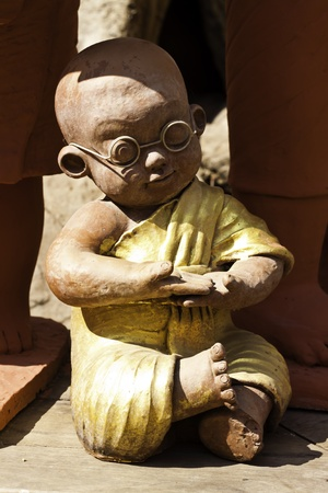 The monk statue at the temples in Aduyhaya Thailand. photo