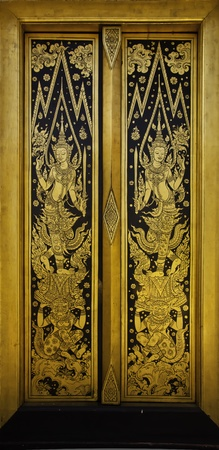 The golden door at the Thai temple architecture of temple is marvellous painted and decorated. Stock Photo - 11979385