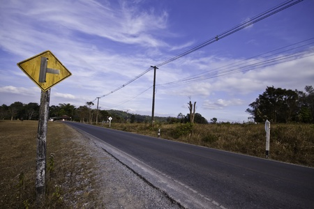 trip hazard sign: The country road in the landscape of fresh blue sky.