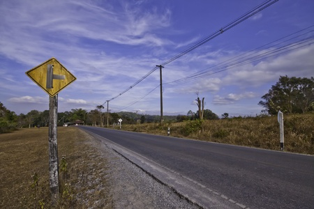 The country road in the landscape of fresh blue sky. Stock Photo - 11999689