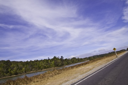 The country road in the landscape of fresh blue sky. Stock Photo - 11999674