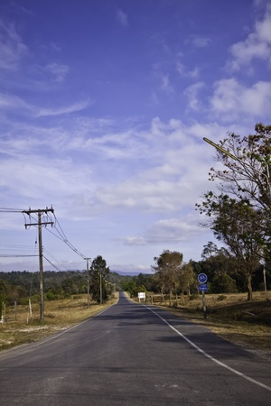 The country road in the landscape of fresh blue sky. Stock Photo - 12304191