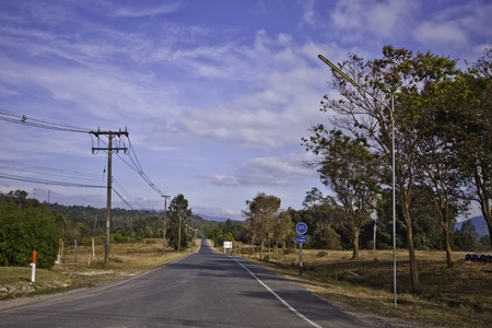 The country road in the landscape of fresh blue sky. Stock Photo - 12304192