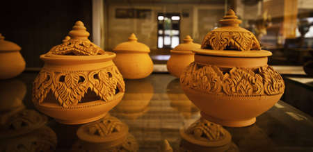 Thai traditional orange mudstone and clay pottery. photo