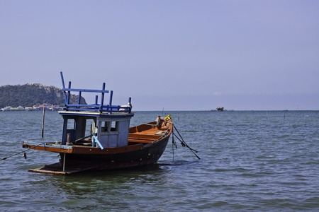 The fishermans boat in the beautiful natural ocean landscape scenery photo