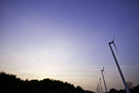 The arrays of wind turbines are on the process of producing the alternatives of the sustainable power. Stock Photo - 12653166