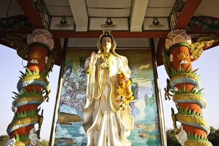 The beautiful golden Guan Yin statue at Khoksamrong shrine of Thailand is worth for salutation. photo