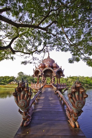 The beautiful red wooden Garuda shrine in the outdoor landscape at the ancient city in Samutprakarn of Thailand  Stock Photo - 12871850