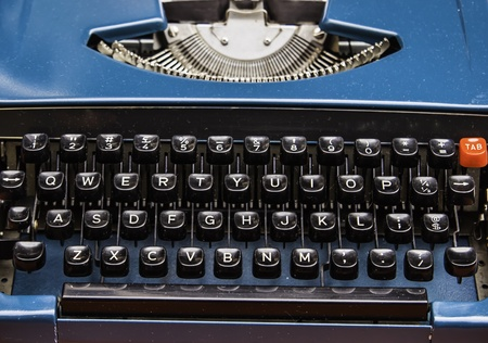 The old model typewriter's alphabet keys and console. It is the best friend of writer. photo