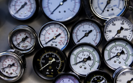 The group of pressure gauges in the various sizes and models. Stock Photo